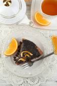 Cake with Chocolate Glaze and orange on plate, on wooden background — Stock Photo