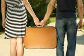 Couple with vintage suitcase — Stock Photo