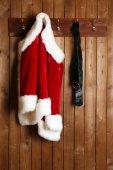 Santa costume on wooden wall — Stock Photo