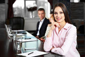Businesswoman and business people working in conference room — Stock Photo