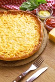 Tasty cheese pizza on table — Stock Photo