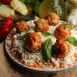Meat balls in tomato sauce with boiled rice and lentil, wooden spoon on wooden background — Stock Photo #79069500