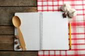 Open recipe book on napkin — Stock Photo