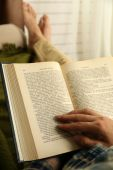 Young man reading book — Stock Photo