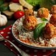 Meat balls in tomato sauce with boiled rice and lentil, wooden spoon on wooden background — Stock Photo #79070060