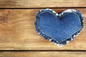 Denim heart on wooden background — Stock Photo