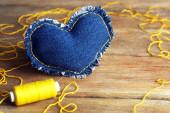 Denim heart and thread — Stock Photo