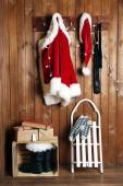 Santa costume hanging on wooden wall background — Stock Photo