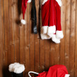 Santa costume hanging on wall — Stock Photo #79723710