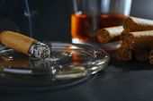 Cigars and burning one with whiskey — Stock Photo