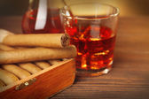 Cigars with glass of cognac — Stock Photo