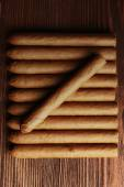 Cigars on wooden table, top view — Stock Photo