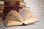 Heap of old books on table close up — Stock Photo
