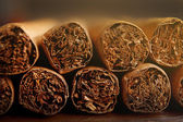 Cigars on wooden table, closeup — Stock Photo