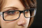 Attractive young woman with glasses close up — Stock Photo