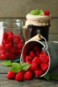 Sweet raspberries in decorative bucket — Stock Photo