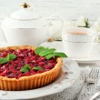 Tart with raspberries and tasty tea, on color  wooden background — Stock Photo #80280138