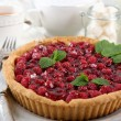 Tart with raspberries and tasty tea, on color  wooden background — Stock Photo #80280152