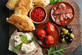 Ingredients of Mediterranean cuisine, on wooden board, close-up — Stock Photo
