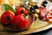 Ingredients of Mediterranean cuisine, on wooden tray, on wooden background — Stock Photo