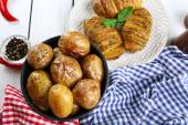 Baked potatoes on wooden table, top view — Stock Photo