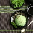 Green tea ice-cream on bamboo mat — Stock Photo #80661610