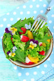 Light organic salad with flowers, close up — Stock Photo
