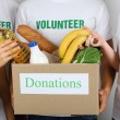 Volunteer holding donation box with food — Stock Photo #80894374