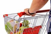 Young man with shopping cart close up — Stock Photo