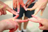 Hands of young people with Indian dyes on Holi color festival — Stock Photo