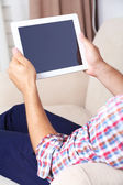Male hand holding PC tablet — Stock Photo