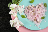 Tableware with flowers on table close up — Stock Photo