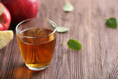 Glass of apple juice and fruits on table close up — Stock Photo