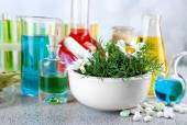 Herbs in mortar, test tubes — Stock Photo
