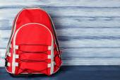 School backpack on wooden background — Stock Photo