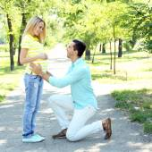 Pregnant woman with husband in park — Stock Photo
