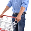 Young man with empty shopping cart, isolated on white — Stock Photo #81424896
