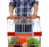 Young man with shopping cart — Stock Photo
