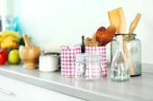 Composition with different utensils on wooden wooden table in kitchen — Stock Photo