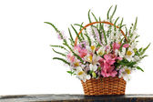 Beautiful floral arrangement in basket isolated on white — Stock Photo