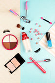 Cosmetic on colorful paper background — Stock Photo
