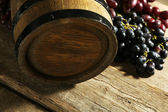 Old wine barrel and grape — Stock Photo