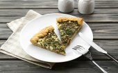 Slices of open pie with spinach on table close up — Stock Photo
