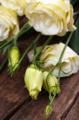 Beautiful eustoma on wooden table close up — Stock Photo