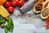 Pasta penne with tomatoes, cheese and basil on color wooden  background — Stock Photo