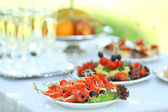 Snacks, fruits and drinks on table, outdoors. Garden party concept — Stock Photo