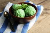 Homemade mint ice-cream on wooden background — Stock Photo