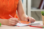 Woman write on notebook on workplace close up — Stock Photo