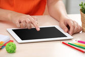 Woman using digital tablet on workplace close up — Stock Photo