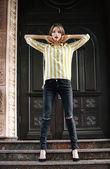 Beautiful young girl posing on city street — Stock Photo